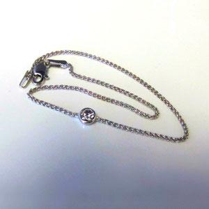 BR 9 - 14K white gold bracelet with channel set diamond.