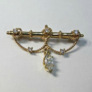 PB 11 - 14K yellow gold antique reproduction with melee diamonds and a marquise shaped diamond dangle.