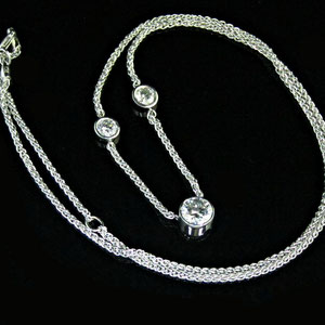 P 51 - 14k white gold necklace with bezel set diamonds.