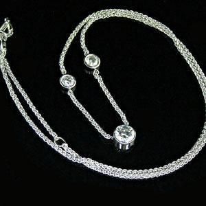 P 51 - 14k white gold necklace with bezel set diamonds.