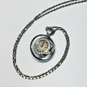 E 32 - 14K white gold pendand made from heirloom watch parts.