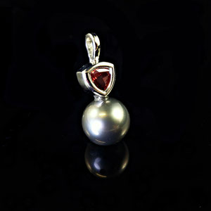 P 126 - 14K two tone pendant with black pearl and garnet trillion.