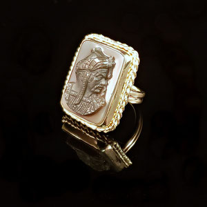 CS 53 - 14K yellow gold ring with bezel set carved stone.
