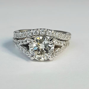 WF 2/2.1 - 14K white gold diamond wedding set.