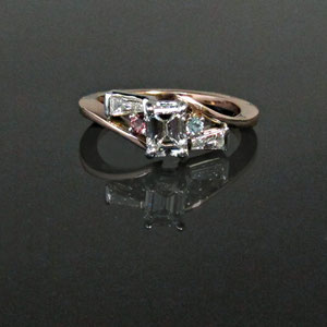 DF 8 - 14K two toned gold bypass ring with center emerald cut diamond, baguette diamonds, pink tourmaline, and aquamarine.
