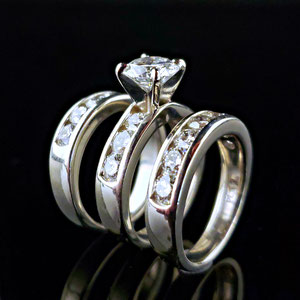 DF 43 - Platinum wedding set with center diamond and channel set diamonds.