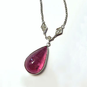 P 106 - 14K white gold bezel set pear shaped rubellite with diamond accents.