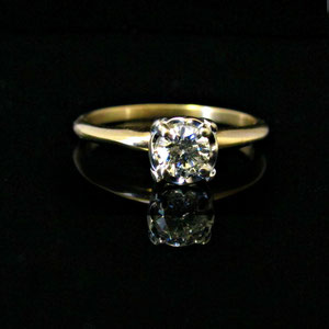 WF  31 - 14K two toned illusion mounting diamond ring.
