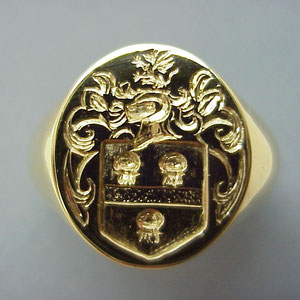 G 10 - 14K yellow gold hand engraved crest ring.