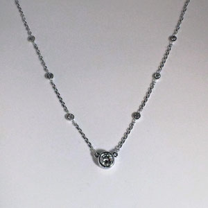 P 53 - 14K white gold diamonds by the yard necklace.