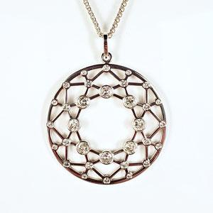 P 101 - 14K white gold 'diamond shaped' pendant with bezel set diamonds.