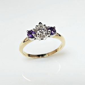 WF 45 - 14K two tone engagement ring with center pear shaped diamond, and two amethysts.