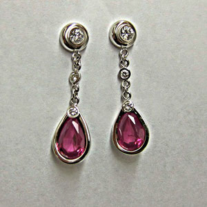 E 22 - 14K white gold earrings with diamonds and pink tourmalines.