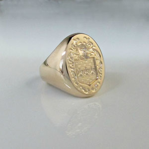 G 11 - 14K yellow gold hand engraved crest ring.