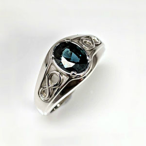 G 22 - 14K white gold ring with oval sapphire.