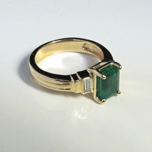 CS 15 - 14K yellow gold ring with center emerald and side baguette diamonds.