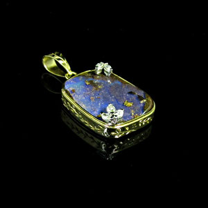 P 15 - 14K yellow gold pendant with boulder opal and marquise diamonds.