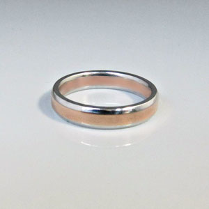 B 20 - 14K rose and white gold wedding band.