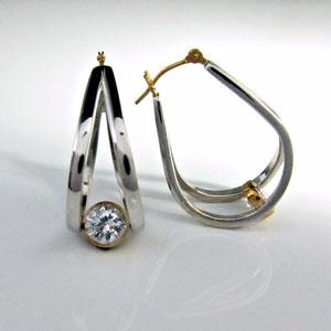 E 88 - 14k two tone gold fabricated hoop earrings with bezel set cubic zirconia.