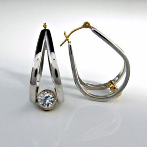 E 88 - 14k two tone gold fabricated hoop earrings with bezel set cubic zirconia.