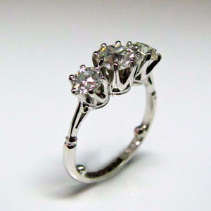 DF 34 - 14K white gold 3 stone diamond ring.  This ring has sizing shot inside the shank.