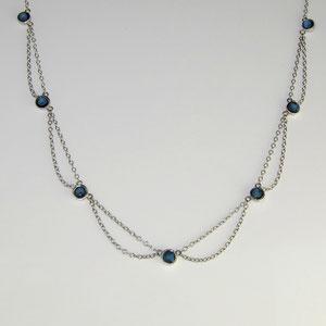 P 19 - 14K white gold chain with bezel set sapphires.