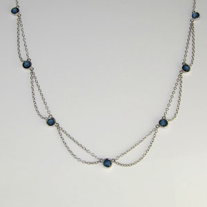 P 19 - 14K white gold chain with bezel set sapphires.