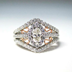 DF 25 - 14K white gold ring with center marquise shaped diamond, surrounded by melee' diamonds, with rose gold accents.