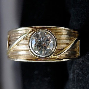WF 1 - 14K yellow gold ring with bezel set diamond.