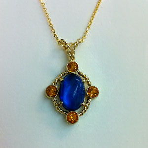 JS 3.2 - 14K yellow gold pendant featuring a kyanite center and four bezel set citrines with twist wire accents.