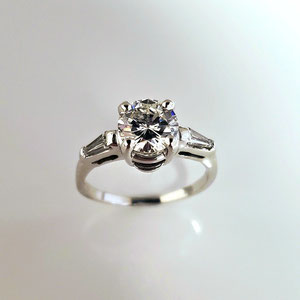 DF 46 - 14K white gold  ring with center round diamond and two tapered baguettes.