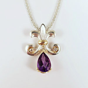 P 100 - Sterling and 14K yellow gold pendant with diamonds and a pear shaped amethyst.