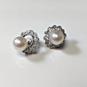E 109 - 14K white gold diamond jackets for stud earrings.
