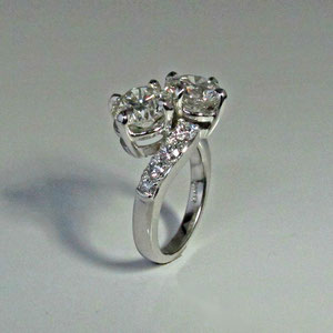 DF 13 - 14K white gold bypass ring with 2 center diamonds and melee diamonds.