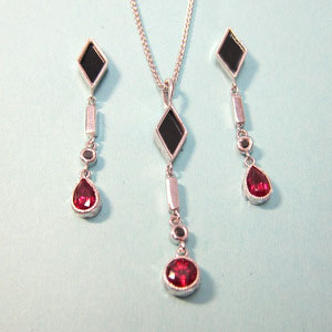 JS 2 - 14K white gold pendant and earrings with white and black diamonds, onyx, and garnet.