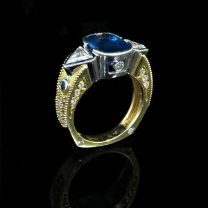 CS 24 - 18k yellow gold and platinum CAD designed ring featuring a fancy cut sapphire and accented with diamonds and sapphires.