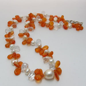 P 41 - Carnelian, peach pearl, and quartz bead necklace with a sterling silver clasp.