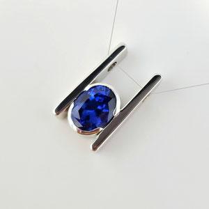 P 105 - 14K white gold slide pendant with bezel set sapphire.