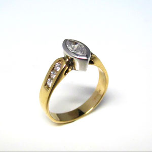 DF 22 - 14K two toned ring with bezel set marquise diamond and channel set diamonds.