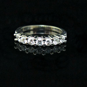 B 17 -  14K white gold shared prong diamond band.