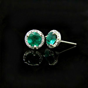 E 89 - 14K white gold halo style earrings with diamonds and emeralds.