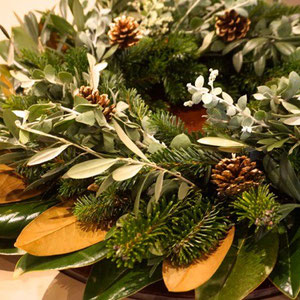 Dec 7th Table centerpiece wreath made from neighbor's magnolia and brunches from my garden.