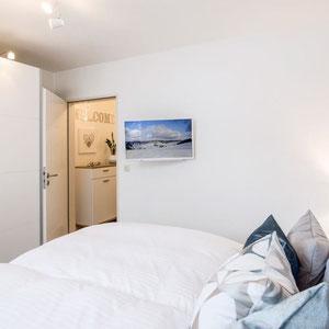 TV im Schlafzimmer - Ferienwohnung Winterberg