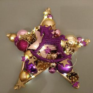 Stern in violett - gold mit LED - Lichterkette