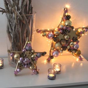 Leuchtstern in rosa - gold handgefertigt mit Teelichtern dekoriert.