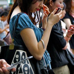 Some girls use the camera to check their make up. Tokyo, Japan 2013 © Sabrina Iovino   JustOneWayTicket.com