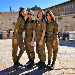 Very friendly (and very attractive!!) girls from the Army, posing in front of the Western Wall. Jerusalem, Israel © Sabrina Iovino   JustOneWayTicket.com