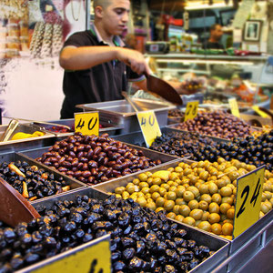 Olives in all sizes and colors... Mahane Yehuda Market in Jerusalem, Israel © Sabrina Iovino   JustOneWayTicket.com