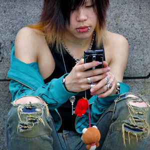 Japanese teenage guy and his cell phone. Harajuku, Tokyo, Japan 2013 © Sabrina Iovino