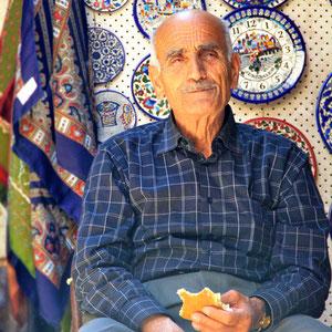 An older guy, having a break in front of his shop in the old City. Jerusalem, Israel © Sabrina Iovino   JustOneWayTicket.com